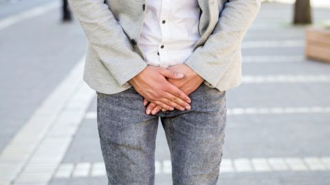young man prostate problem on walking street