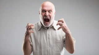 this man is growing so angry that he could get mad or transform himself into a wolf - anger management concept (funny version)
