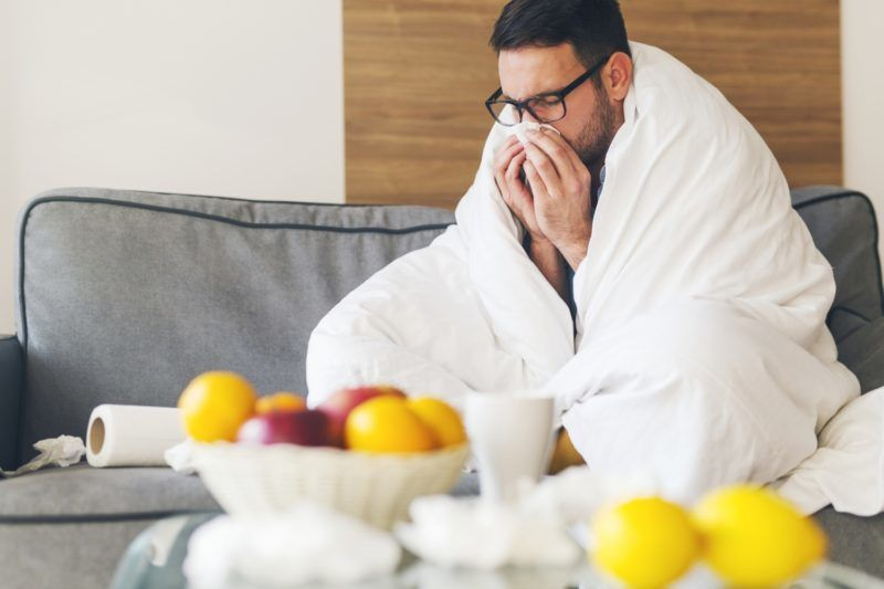 Young man suffering from cold at home