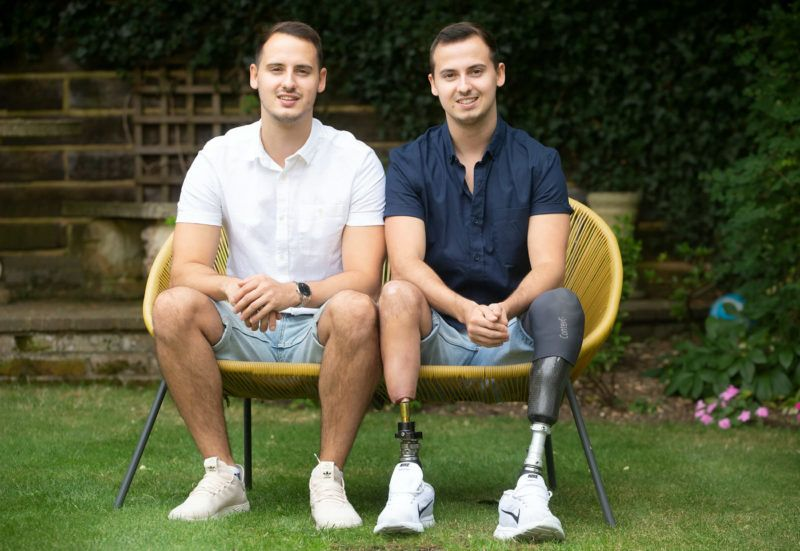 om and James Bertrand photographed in July 2018. See SWNS story SWTPleg; A 20-year-old man plagued with leg pain due to a rare condition has paid £64,000 to have his remaining leg cut off - after being inspired by a dog on TV's The Supervet. James Bertrand, from Chalfont St Peter, Bucks, flew to Australia in May this year to have part of his right leg amputated. He raised more than £60,000 in 14 months and took the brave decision to have life-changing surgery in Sydney to remove his right foot and lower leg. But he only did so after watching The Supervet on Channel 4 and seeing vets fit a dog with a prosthetic leg. James became inspired to pursue osseointegration surgery - an operation that involved hollowing out the bone in his leg and fitting a prosthetic limb - after watching the show. ***EXCLUSIVE***