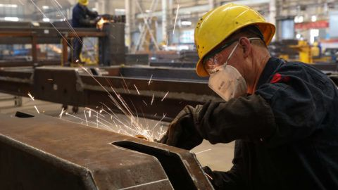 (FILES) This file picture taken on October 18, 2018 shows a worker welding truck parts at a factory in Weihai in China's eastern Shandong province. - Chinese consumer spending slowed in October, official data showed on November 14, adding to worries over the world's second-largest economy, but investment and industrial production appeared to stabilise. (Photo by STR / AFP) / - China OUT