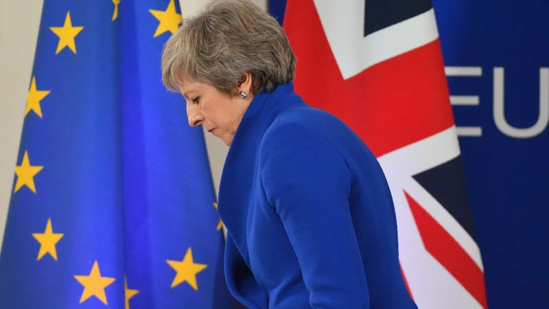 """Britain's Prime Minister Theresa May leaves after a press conference following a special meeting of the European Council to endorse the draft Brexit withdrawal agreement and to approve the draft political declaration on future EU-UK relations on November 25, 2018 in Brussels. - The European Union's top official urged British lawmakers to ratify the Brexit deal Prime Minister Theresa May has negotiated with European leaders, warning it will not be modified.""""This is the best deal possible for Britain, this is the best deal possible for Europe. This is the only deal possible,"""" Jean-Claude Juncker, the president of the European Commission, said after a Brussels summit. (Photo by EMMANUEL DUNAND / AFP)"""