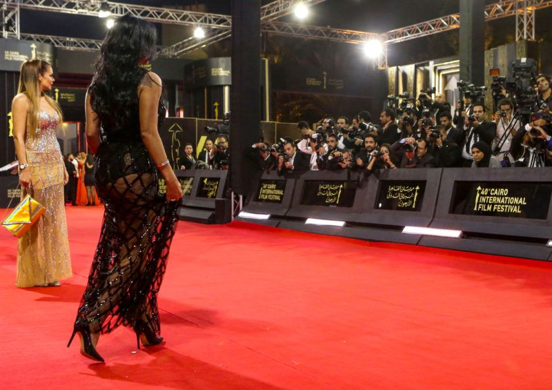 """Egyptian actress Rania Youssef walks on the red carpet at the closing ceremony of the 40th edition of the Cairo International Film Festival (CIFF) at the Cairo Opera House in the Egyptian capital on November 29, 2018. - Youssef is to face trial in January 2019 for appearing at the closing ceremony of the Cairo International Film Festival wearing a revealing black lacy dress over a tight black body with her legs showing underneath, a judicial source said on December 1. This prompted two lawyers to lodge a suit against her accusing the actress of """"inciting debauchery"""", a charge that could land her in jail for up to five years if she is convicted. (Photo by PATRICK BAZ / Cairo International Film Festival / AFP) / RESTRICTED TO EDITORIAL USE - MANDATORY CREDIT """"AFP PHOTO / CAIRO INTERNATIONAL FILM FESTIVAL"""" - NO MARKETING - NO ADVERTISING CAMPAIGNS - DISTRIBUTED AS A SERVICE TO CLIENTS"""