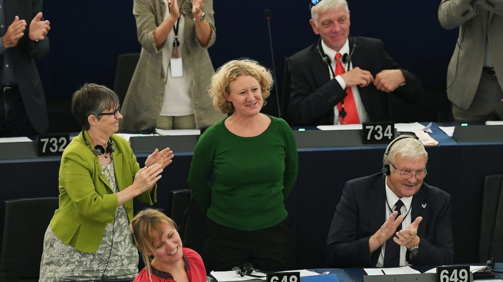 Member of European Parliament Judith Sargentini (C) reacts after the vote on the situation in Hungary during a voting session at the European Parliament on September 12, 2018 in Strasbourg, eastern France. (Photo by FREDERICK FLORIN / AFP)