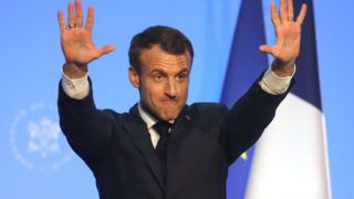 "France's President Emmanuel Macron gestures during a meeting with the French Community, at the Usina del Arte in Buenos Aires on November 29, 2018, on the eve of the G20 Leaders' Summit. - Macron arrived on the eve for a two-day G20 summit beginning on November 30 likely to be dominated by simmering international tensions over trade. In an interview with Argentine daily La Nacion, he warned against the risk of ""a destructive trade war for all"" emanating from the G20 discussions. (Photo by Ludovic MARIN / AFP)"