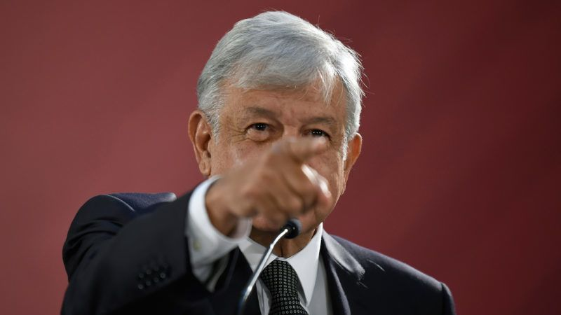"""Mexico's President Andres Manuel Lopez Obrador gestures as he gives his first press conference as president, at the National Palace in Mexico City on December 3, 2018. - Anti-establishment leftist Andres Manuel Lopez Obrador vowed a """"deep and radical"""" change in Mexico as he assumed the country's presidency on December 1. (Photo by Alfredo ESTRELLA / AFP)"""