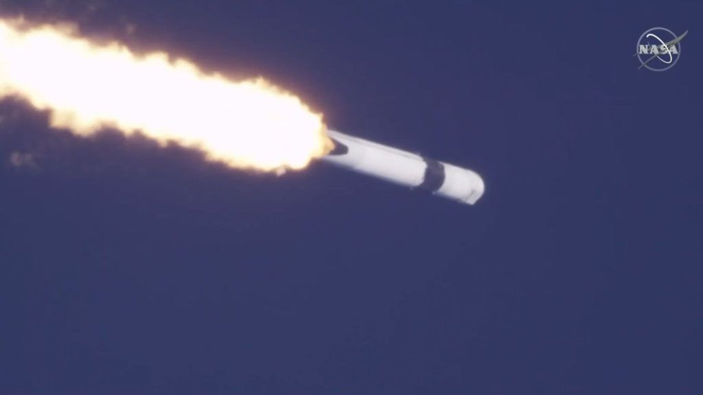 """In this still photo from NASA TV, SpaceX launches its unmanned Dragon cargo ship, loaded with supplies, science experiments and food for the astronauts living at the International Space Station from Cape Canaveral, Florida, on December 5, 2018. - SpaceX's Falcon 9 rocket soared into the sunny, blue sky over Cape Canaveral, Florida at 1:16 pm (1816 GMT), carrying 5,600 pounds (2,500 kilograms) of gear. The mission is SpaceX's 16th for NASA, as part of a long-term contract with NASA to ferry supplies to space. (Photo by HO / NASA TV / AFP) / RESTRICTED TO EDITORIAL USE - MANDATORY CREDIT """"AFP PHOTO / NASA TV"""" - NO MARKETING NO ADVERTISING CAMPAIGNS - DISTRIBUTED AS A SERVICE TO CLIENTS"""
