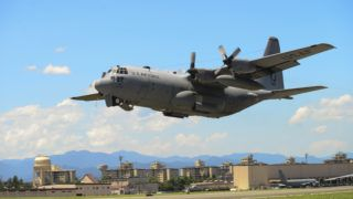 """(FILES): In this July 14, 2015 photograph courtesy of the US Air Force, a C-130 Hercules takes off during a training exercise at Yokota Air Base, Japan. - Two US Marine Corps aircraft crashed during a refueling operation off the coast of Japan, a US defense official told AFP on Wednesday, December 5, 2018. The planes involved were an F-18 fighter and a C-130 tanker, the official said. In a statement, the Marine Corps said the planes had taken off from Marine Corps Air Station Iwakuni in southern Japan. Search and rescue operations were underway following a """"mishap."""" (Photo by David OWSIANKA / US AIR FORCE / AFP) / == RESTRICTED TO EDITORIAL USE  / MANDATORY CREDIT:  """"AFP PHOTO /  US AIR FORCE / Senior Airman David OWSIANKA"""" / NO MARKETING / NO ADVERTISING CAMPAIGNS /  DISTRIBUTED AS A SERVICE TO CLIENTS  =="""