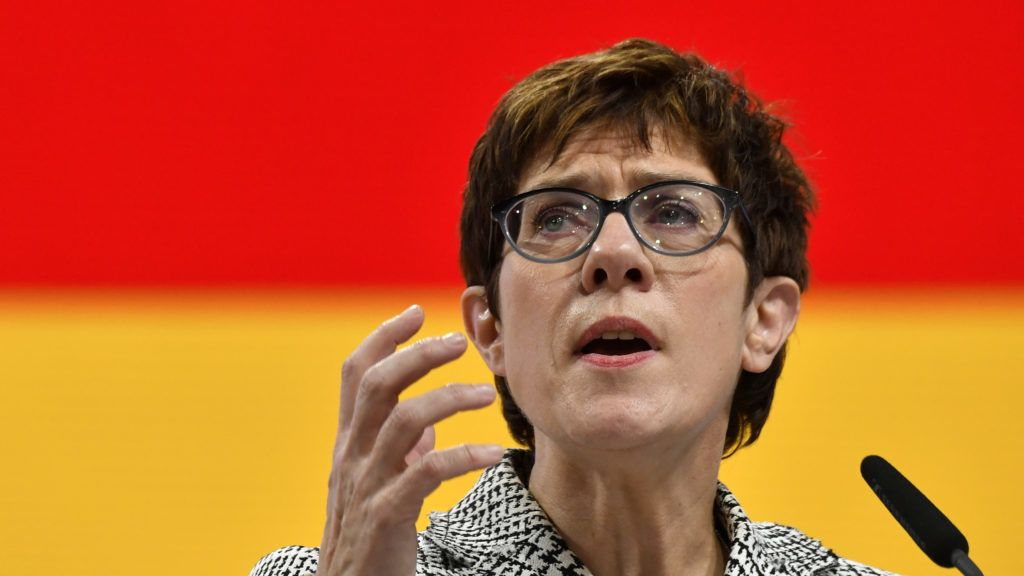 The Secretary General of the Christian Democratic Union (CDU) and candidate for the party's leadership  Annegret Kramp-Karrenbauer gives a speech during a party congress to determine German chancellor's successor on December 7, 2018 at a fair hall in Hamburg, northern Germany. - German Chancellor Angela Merkel will hand off leadership of her party after nearly two decades at the helm, with the race wide open between a loyal deputy and a longtime rival. (Photo by John MACDOUGALL / AFP)