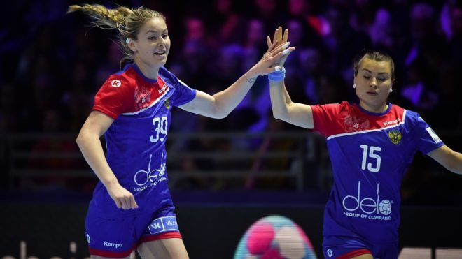 Russia's right back Antonina Skorobogatchenko (L) and Russia's right wing Marina Sudakova celebrate a goal during the Women Euro 2018 handball Championships Group 1 main round match between Denmark and Russia, on December 10, 2018, at the XXL hall in Nantes, western France. (Photo by LOIC VENANCE / AFP)