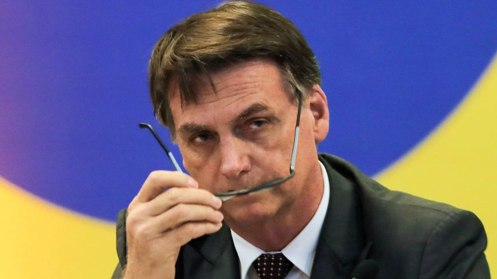 (FILES) In this file photo taken on November 14, 2018 Brazil's President-elect Jair Bolsonaro, gestures during a meeting with the newly elected governors in Brasilia. - Brazil's next president, Jair Bolsonaro, takes office on January 1, 2019 with promises to radically change the path taken by Latin America's biggest country by trashing decades of center-left policies. But while the far-right politician enjoys sky-high popularity of 75 percent going into the top job, the challenges to his agenda are formidable. (Photo by Sergio LIMA / AFP)