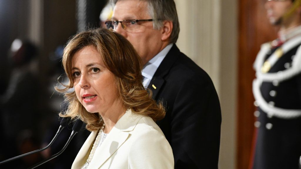 Luigi Gaetti (R) and and Giulia Grillo, representatives of the Five Star Movement (M5S) attend a press point following a meeting with Italy's President Sergio Mattarella on December 10, 2016 at the Quirinale Palace in Rome. Representatives of Italy's main parties are headed to the presidential palace, their task to agree on a new government made even more urgent by fears of a banking crisis in the eurozone's third-largest economy. - Italy was plunged into political uncertainty by the resignation of Prime Minister Matteo Renzi following a crushing referendum defeat. (Photo by VINCENZO PINTO / AFP)