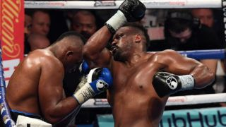 England's Dillian Whyte (L) and England's Derick Chisora fight during the WBC World Heavyweight Title Eliminator & WBC International Championship boxing match in Manchester, north-west England on December 10, 2016. (Photo by Paul ELLIS / AFP)