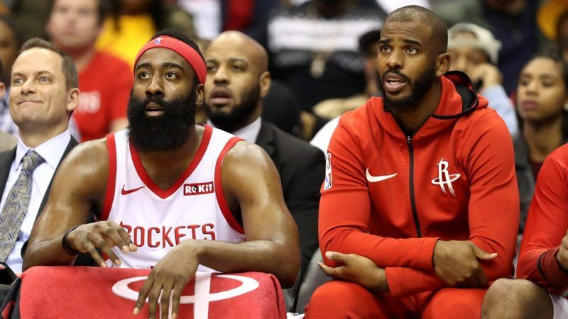 WASHINGTON, DC - NOVEMBER 26: James Harden #13 and Chris Paul #3 of the Houston Rockets (R) talk on the bench in the first half against the Washington Wizards at Capital One Arena on November 26, 2018 in Washington, DC. NOTE TO USER: User expressly acknowledges and agrees that, by downloading and or using this photograph, User is consenting to the terms and conditions of the Getty Images License Agreement.   Rob Carr/Getty Images/AFP
