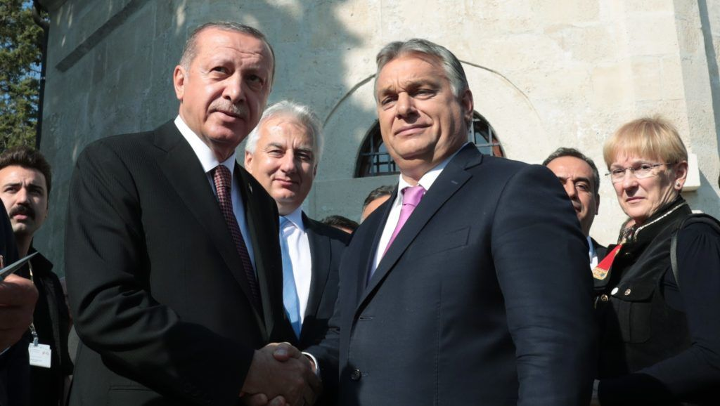 """BUDAPEST, HUNGARY - OCTOBER 9: (----EDITORIAL USE ONLY – MANDATORY CREDIT - """"TURKISH PRESIDENCY / MURAT CETINMUHURDAR / HANDOUT"""" - NO MARKETING NO ADVERTISING CAMPAIGNS - DISTRIBUTED AS A SERVICE TO CLIENTS----) President of Turkey, Recep Tayyip Erdogan (Front L) and Prime Minister of Hungary Viktor Orban (Front R) shake hands during the opening ceremony of Tomb of Gul Baba, renovated in cooperation of Turkish and Hungarian governments, on October 09, 2018 in Budapest, Hungary. Turkish Presidency / Murat Cetinmuhurdar / Handout / Anadolu Agency"""