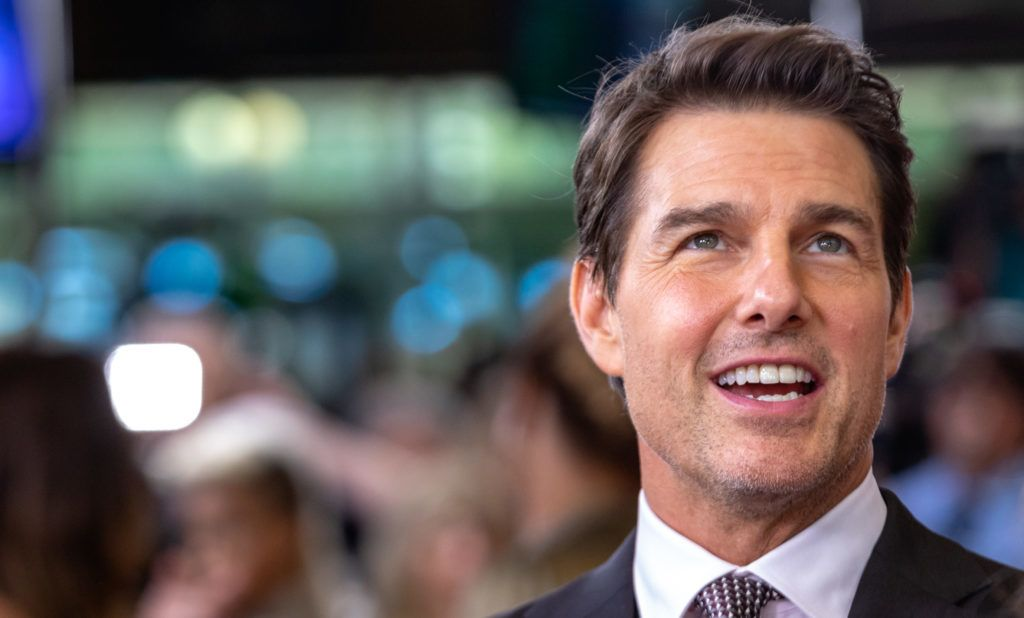 "Producer and Actor Tom Cruise, who plays ""Ethan Hunt"" in Mission: Impossible  Fallout, talks to reporters on the red carpet of the U.S. premiere at the Smithsonian National Air and Space Museum in Washington, D.C., on Sunday, July 22, 2018.  (Photo by Cheriss May/NurPhoto via Getty Images)"