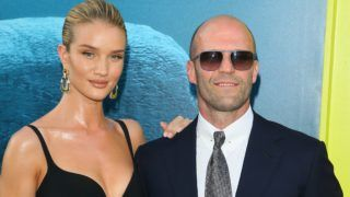 "HOLLYWOOD, CA - AUGUST 06: Rosie Huntington-Whiteley and Jason Statham attend the premiere of Warner Bros. Pictures and Gravity Pictures' Premiere of ""The Meg"" on August 06, 2018 in Hollywood, California. (Photo by JB Lacroix/WireImage)"