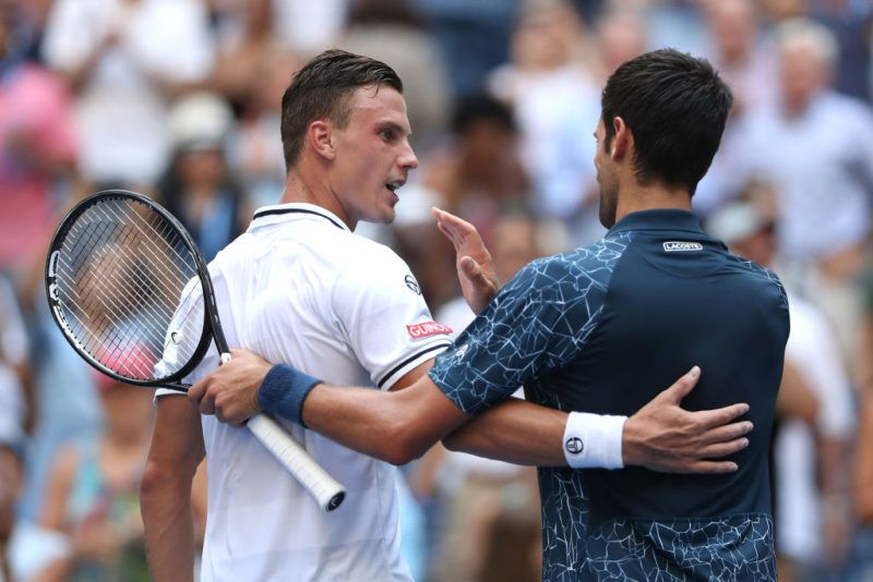 NEW YORK, NY - AUGUST 28:  Novak Djokovic of Serbia shakes hands with Marton Fucsovics of Hungary after his win in the men's singles first round match on Day Two of the 2018 US Open at the USTA Billie Jean King National Tennis Center on August 28, 2018 in the Flushing neighborhood of the Queens borough of New York City.  (Photo by Matthew Stockman/Getty Images)