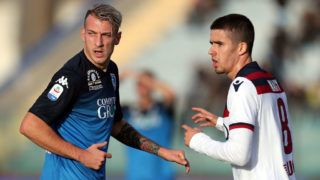EMPOLI, ITALY - DECEMBER 09: Antonino La Gumina of Empoli FC and Adam Nagy of Bologna FC during the Serie A match between Empoli and Bologna FC at Stadio Carlo Castellani on December 9, 2018 in Empoli, Italy.  (Photo by Gabriele Maltinti/Getty Images)