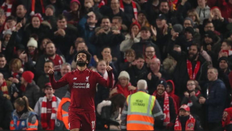 LIVERPOOL, ENGLAND - DECEMBER 11: Mohamed Salah of Liverpool celebrates after scoring a goal to make it 1-0 during the UEFA Champions League Group C match between Liverpool and SSC Napoli at Anfield on December 11, 2018 in Liverpool, United Kingdom. (Photo by Matthew Ashton - AMA/Getty Images)