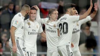 MADRID, SPAIN - DECEMBER 15: Karim Benzema of Real Madrid celebrates 1-0 with Karim Benzema of Real Madrid, Lucas Vazquez of Real Madrid, Luka Modric of Real Madrid, Marco Asensio of Real Madrid  during the La Liga Santander  match between Real Madrid v Rayo Vallecano at the Santiago Bernabeu on December 15, 2018 in Madrid Spain (Photo by David S. Bustamante/Soccrates/Getty Images)