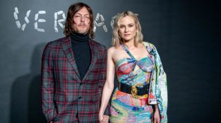 NEW YORK, NEW YORK - DECEMBER 02: Norman Reedus and Diane Kruger attend the the Versace fall 2019 fashion show at the American Stock Exchange Building in lower Manhattan on December 02, 2018 in New York City. (Photo by Roy Rochlin/Getty Images)