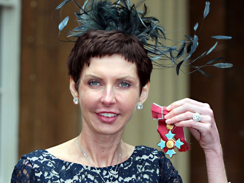 LONDON, UNITED KINGDOM - MAY 15: bet365 Chief Executive Denise Coates poses with her Commander of the British Empire (CBE) medal, which was presented by Prince Charles, Prince of Wales at an Investiture ceremony at Buckingham Palace on May 15, 2012 in London, England.  (Photo by Sean Dempsey - WPA Pool/Getty Images)