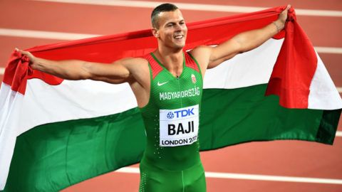 LONDON, ENGLAND - AUGUST 07:  Balazs Baji of Hungary, bronze, celebrates with his countries flag after the Men's 110 metres hurdles final during day four of the 16th IAAF World Athletics Championships London 2017 at The London Stadium on August 7, 2017 in London, United Kingdom.  (Photo by David Ramos/Getty Images)
