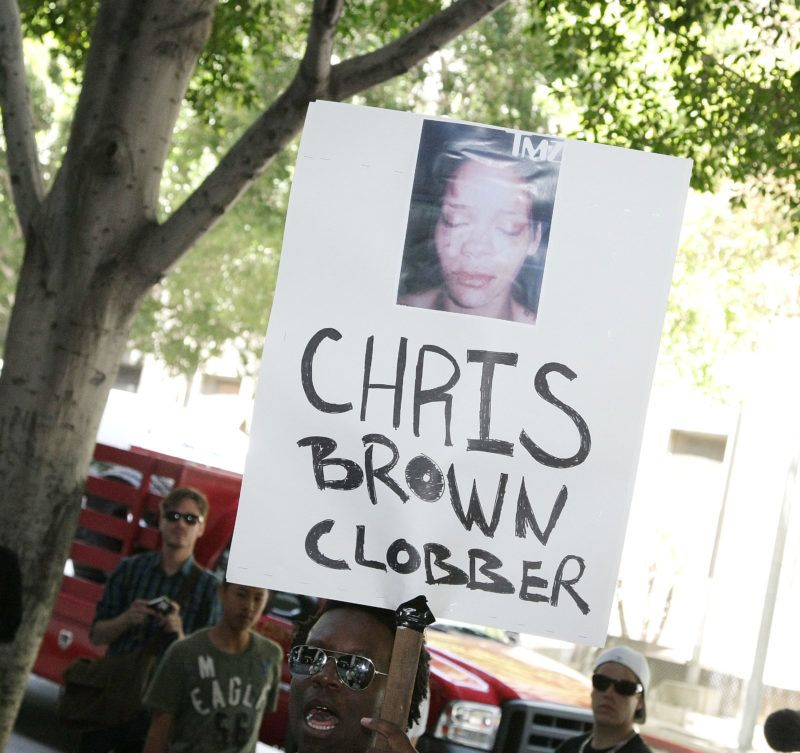 LOS ANGELES, CA - JUNE 22:  A person holds up a sign as singer Chris Brown arrives to the Criminal Courts Building for a preliminary hearing to determine if he will stand trial for allegedly attacking pop singer Rihanna on June 23, 2009 in Los Angeles, California. Brown is accused of assaulting and threatening his then-girlfriend, pop star Rihanna, during an argument in a rented Lamborghini sports car following a pre-Grammy Awards party on February 8. The singer is currently free on $50,000 bail.  (Photo by Noel Vasquez/Getty Images)