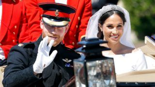 WINDSOR, UNITED KINGDOM - MAY 19: (EMBARGOED FOR PUBLICATION IN UK NEWSPAPERS UNTIL 24 HOURS AFTER CREATE DATE AND TIME) Prince Harry, Duke of Sussex and Meghan, Duchess of Sussex travel in an Ascot Landau carriage as they begin their procession through Windsor following their wedding at St George's Chapel, Windsor Castle on May 19, 2018 in Windsor, England. Prince Henry Charles Albert David of Wales marries Ms. Meghan Markle in a service at St George's Chapel inside the grounds of Windsor Castle. Among the guests were 2200 members of the public, the royal family and Ms. Markle's Mother Doria Ragland. (Photo by Max Mumby/Indigo/Getty Images)