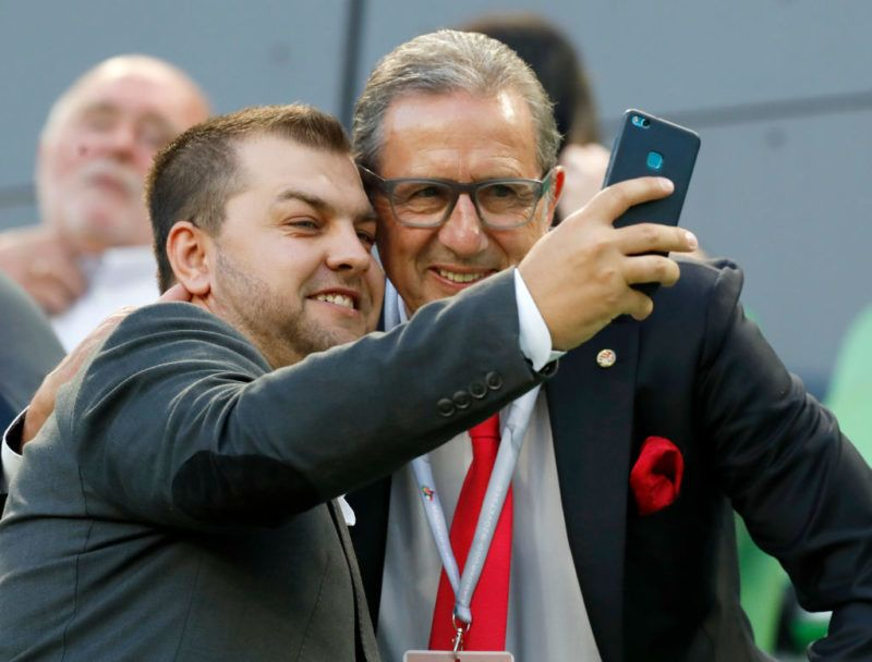 BUDAPEST, HUNGARY - MAY 23: An unidentified person takes a selfie with Hungarian national team's head coach Georges Leekens (r) prior to the Hungarian Cup Final match between Puskas Akademia FC and Ujpest FC at Groupama Arena on May 23, 2018 in Budapest, Hungary. (Photo by Laszlo Szirtesi/Getty Images)