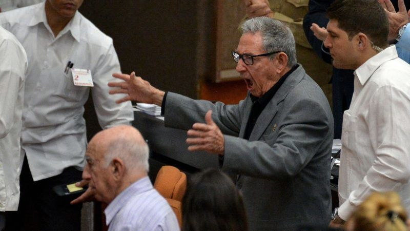 The First Secretary of the Cuban Communist Party, Cuban former president Raul Castro (C), gestures before the debate on the draft new Constitution, during the second regular session of the IX Legislature of the Cuban National Assembly of the Popular Power at the Convention Palace in Havana, on December 21, 2018. - Cuban Parliament meets on Friday to approve the draft new Constitution amended with the contributions of the population, that puts on hold homosexual marriage. The draft will be submitted to a popular referendum on February 24, 2019. (Photo by YAMIL LAGE / AFP)