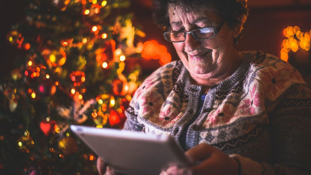 Pretty grandmother video chats with family on Christmas Day