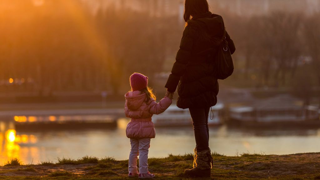 Mother and Daughter walk on a sunny winter day