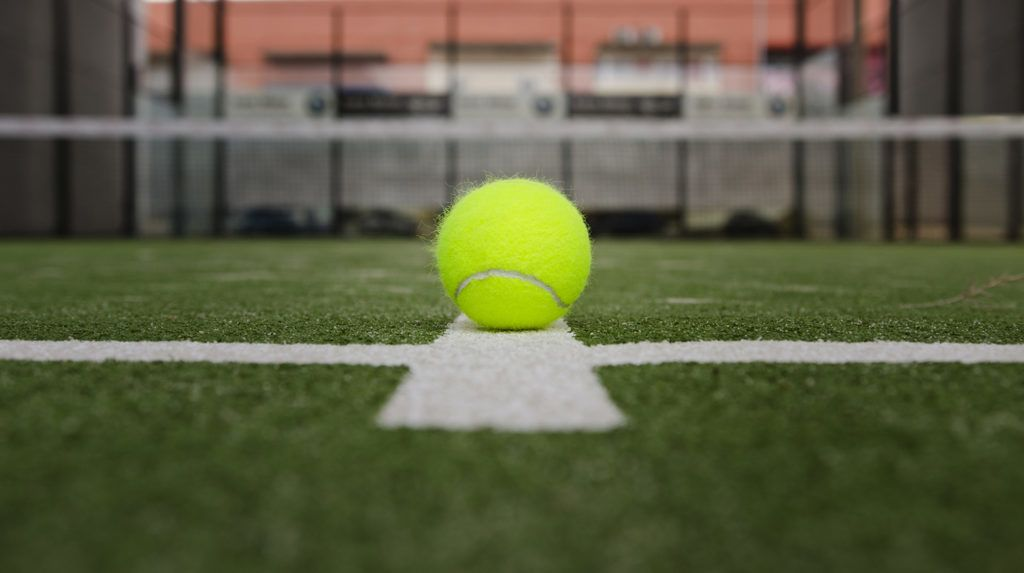Isolated in court paddle tennis ball with short depth of field