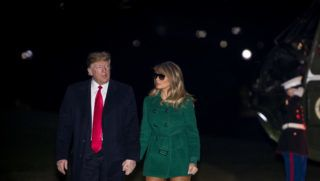 U.S. President Donald Trump and First Lady Melania Trump make their way across the South Lawn of the White House after returning on Marine One from their surprise trip to Al Asad Air Base in Iraq to visit troops, in Washington, DC, USA, December 27, 2018. Photo by Pool/ABACAPRESS.COM