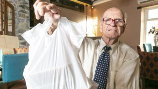 Brian Loughan, 82, Britain oldest takeaway driver. Brian delivers for Kiplings in Sowerby Bridge, Yorkshire.A great-grandad is thought to be Britain's oldest takeaway driver at the grand age of 82 -- and delivers curries in a shirt and tie. Dedicated Brian Loughans hasn't missed a single shift since he started the job at the Indian restaurant in 2014. See SWNS story SWLEtakeaway..Dapper great-grandad Brian Loughans is believed to be Britain's oldest takeaway driver - at the grand age of 82.Brian works on average 18 hours per week and hasn't missed a single shift since he started the job around two-and-a-half-years-ago. The RAF veteran and former cabbie delivers takeaways from the Indian restaurant in his Vauxhall Vectra in all weathers dressed smartly in shirt and tie - and without a SATNAV. He tends to cover the West Yorkshire area but 18 months found himself driving a staggering 112 miles down to West Bromwich for a regular customer.  ***EXCLUSIVE***