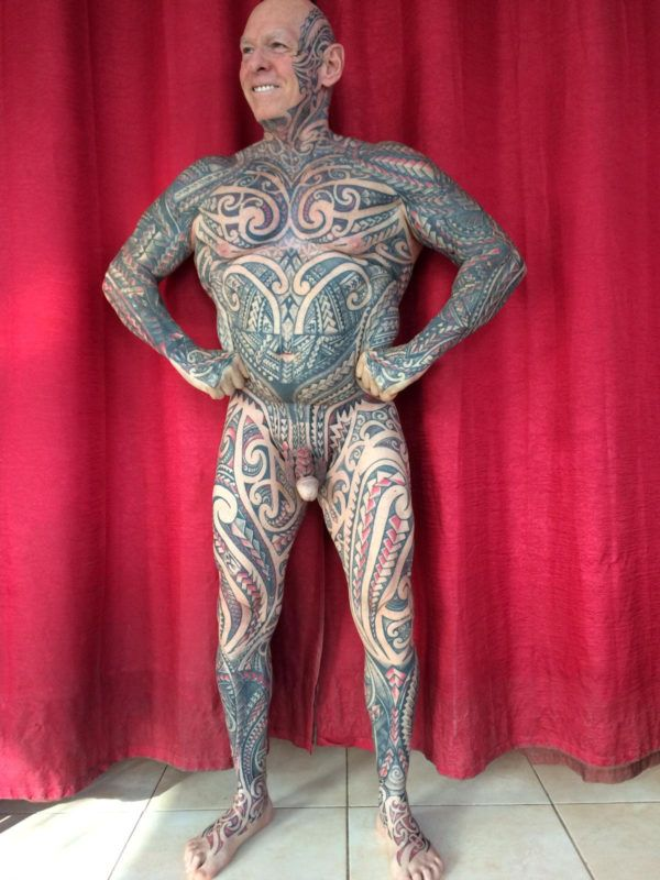 Bodybuilder Ray Houghton shows of his finished tattoo. See SWNS story SWSY tattoo. A bodybuilder wrapped his penis around a kitchen ROLLING PIN to have his entire private parts - including his testicles - covered in tattoos.Buff Ray Houghton, 61, can 'proudly' claim to have at least one tattoo on every body part after undergoing one final four-hour inking - on his gentiles.He now boasts an impressive full body suit of ink which cost £7,500 and required more than 240 hours of tattooing.Ray, from Manchester, has now completed a two year journey to get his body covered in ink after enduring the four hour sitting to have his entire penis and testicles tattooed. ***EXCLUSIVE***