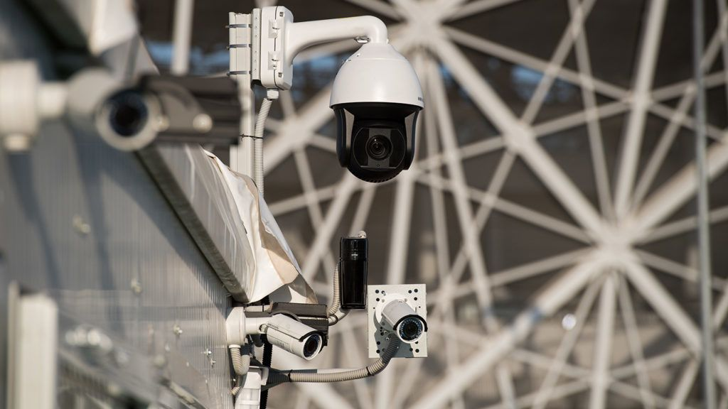 Security cameras are seen outside the Volgograd Arena in Volgograd on June 16, 2018, during the Russia 2018 World Cup football tournament. (Photo by NICOLAS ASFOURI / AFP)