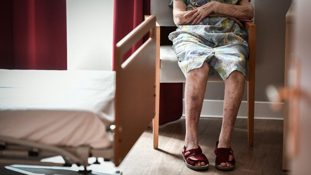An elderly resident sits in her bedroom on July 5, 2018, in an establishment of accommodation for dependent elderly (EHPAD) in Paris. (Photo by STEPHANE DE SAKUTIN / AFP)