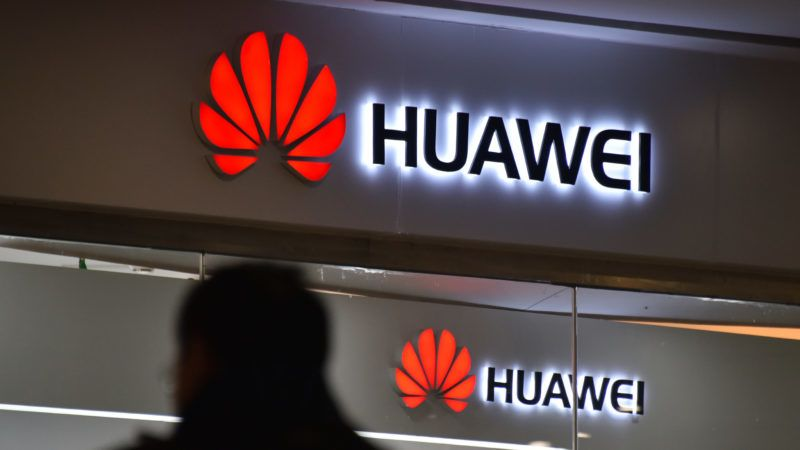 """A man walks past a Huawei store in Beijing on December 10, 2018. - China on December 10 protested Canada's """"inhumane"""" treatment of an executive of telecom giant Huawei who is being held on a US extradition bid, following reports she was not getting sufficient medical care. (Photo by GREG BAKER / AFP)"""