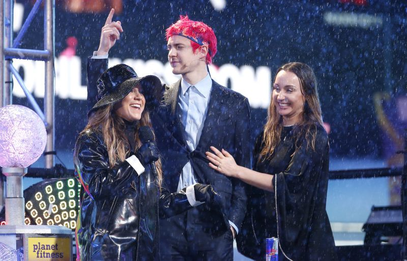 NEW YORK, NEW YORK - DECEMBER 31: Richard Tyler Blevins (aka Ninja) (C) and Jessica Goch on stage during the Times Square New Year's Eve 2019 Celebration on December 31, 2018 in New York City.   John Lamparski/Getty Images/AFP