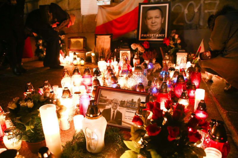 People lit candle during a march throught the center of Warsaw, Poland on January 14, 2019 in commemoration of Pawel Adamowicz, Mayor of Gdansk, who was stabbed on stage on Sunday during a national charity event and died of wounds in a hospital a day after.  (Photo by Beata Zawrzel/NurPhoto)