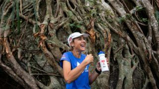 In this picture taken on December 8, 2018, Australian marathon runner Mina Guli rests in front of a tree at the Peak in Hong Kong. - From ankle-deep mud in Central Asia to the scorching heat of Australia, Mina Guli is running 100 marathons in 100 days to highlight a looming global water shortage. (Photo by Philip FONG / AFP) / TO GO WITH Environment-climate-marathon, PHOTOESSAY