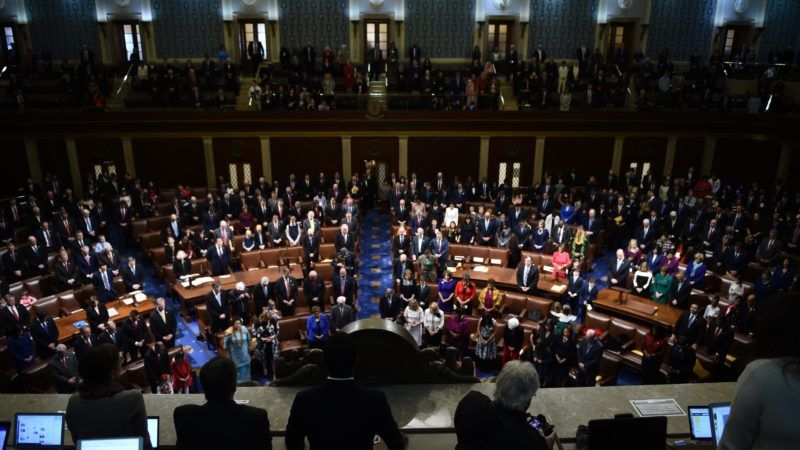 Members of Congress arrive before the start of the 116th Congress and swearing-in ceremony on the floor of the US House of Representatives at the US Capitol on January 3, 2019 in Washington,DC. (Photo by Brendan SMIALOWSKI / AFP)