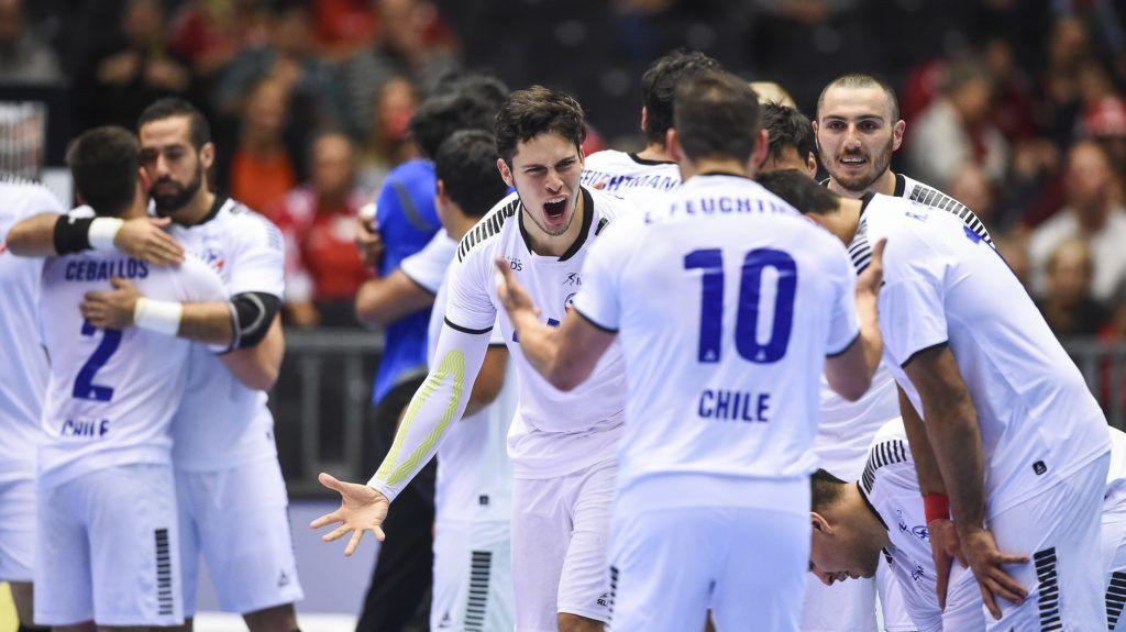 Chile's players celebrate their victory during the IHF Men's World Championship 2019 Group C handball match between Austria and Chile at the Jyske Bank Boxen arena in Herning on January 12, 2019. (Photo by Jonathan NACKSTRAND / AFP)