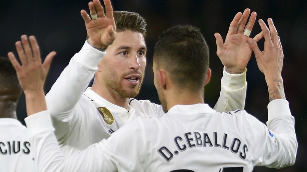 Real Madrid's Spanish defender Sergio Ramos (L) congratulates Real Madrid's Spanish midfielder Daniel Ceballos for his goal during the Spanish League football match between Real Betis and Real Madrid CF at the Benito Villamarin stadium in Seville on January 13, 2019. (Photo by CRISTINA QUICLER / AFP)