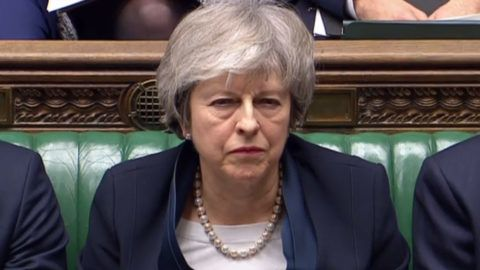 """A video grab from footage broadcast by the UK Parliament's Parliamentary Recording Unit (PRU) shows Britain's Prime Minister Theresa May listen as Britain's opposition Labour Party Leader Jeremy Corbyn speaks in the House of Commons in London on January 15, 2019, before MPs vote on the government's Brexit deal. - Parliament is to finally vote today on whether to support or vote against the agreement struck between Prime Minister Theresa May's government and the European Union. (Photo by HO / PRU / AFP) / RESTRICTED TO EDITORIAL USE - MANDATORY CREDIT """" AFP PHOTO / PRU """" - NO USE FOR ENTERTAINMENT, SATIRICAL, MARKETING OR ADVERTISING CAMPAIGNS"""