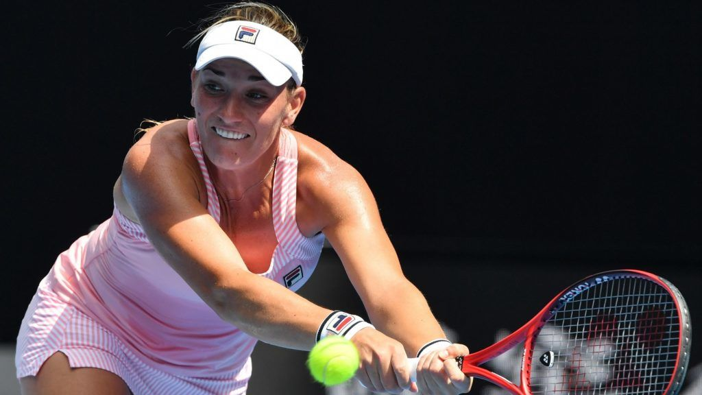 Hungary's Timea Babos hits a return against Sloane Stephens of the US during their women's singles match on day three of the Australian Open tennis tournament in Melbourne on January 16, 2019. (Photo by Peter PARKS / AFP) / -- IMAGE RESTRICTED TO EDITORIAL USE - STRICTLY NO COMMERCIAL USE --
