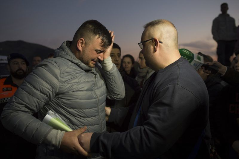 Jose Rosello (L), father of Julen who fell down a well, cries as rescue efforts continue to find the boy in Totalan in southern Spain on January 16, 2019. - Rescuers racing to save a two-year-old boy who fell down a well in southern Spain have found several strands of his hair, authorities said, raising hopes of finding the toddler whose fate has gripped the nation for days. It is the first confirmation that Julen is down the 110-metre (360-foot) deep shaft after family members said he tumbled in while playing as his parents had lunch nearby. (Photo by JORGE GUERRERO / AFP)
